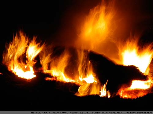 A dead body burns on a funeral pyre