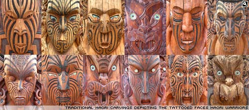 Carved maori faces at Te Puia