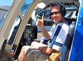 Simon Jones in a helicopter